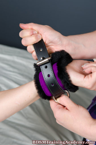 Faux Fir Bondage Cuff Attached To Submissives Wrist